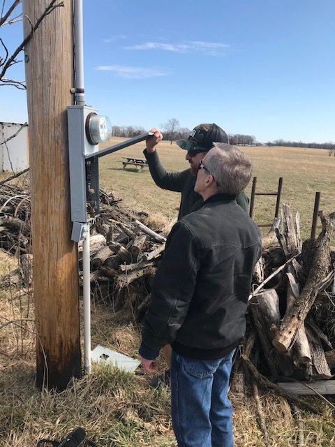 Examining the power panel on the utility pole